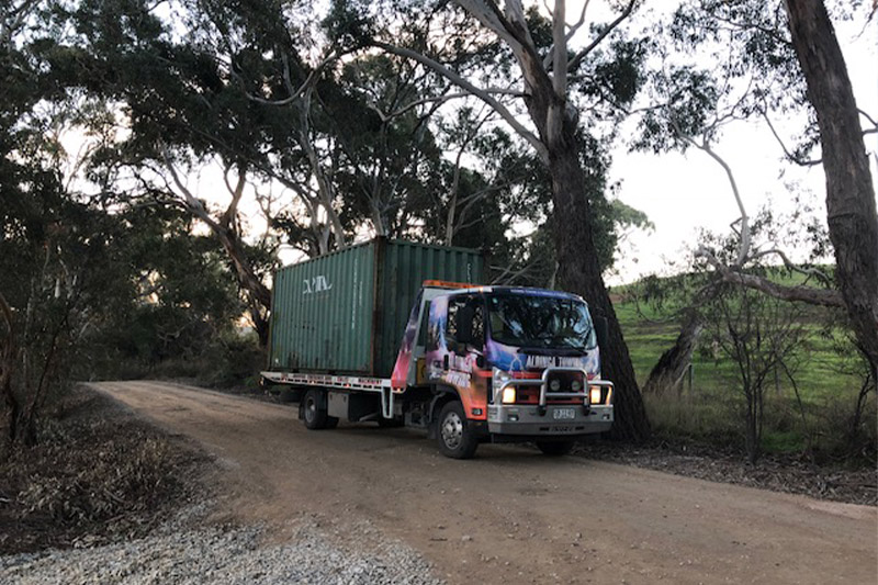 A shipping container that has been hired being delivered by an Aldinga towing truck