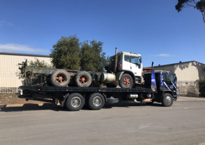 Aldinga heavy tow truck carrying a large truck