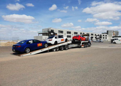 Aldinga heavy tow truck being loaded with three race cars