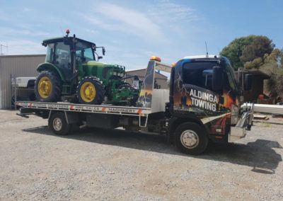 An Aldinga tow truck shifting a tractor