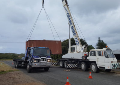 A shipping container being loaded onto Aldinga Towing's truck fro delivery to regional SA