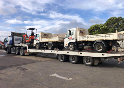 Large Tilt tray truck transporting three vehicles in Adelaide