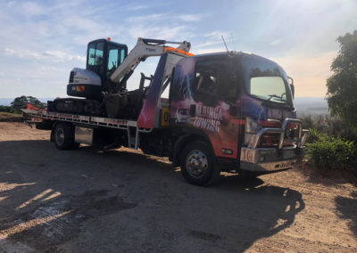 Towing an excavating machine in Adelaide Northern suburbs
