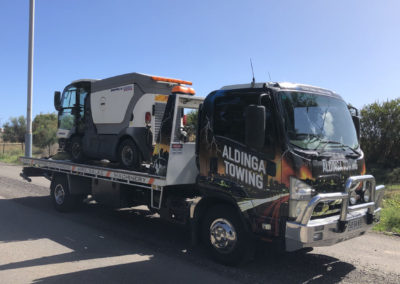 Towing small street sweeping machine in Adelaide