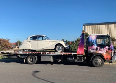A 1959 Jaguar being towed to Victor Harbor
