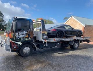 A Porsche Cayenne being towed from Willunga