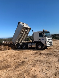 Tandem Tipper dumping fill at Oakbank