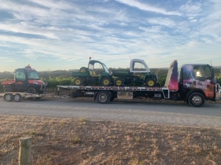 Towing 3 excavators from Magill