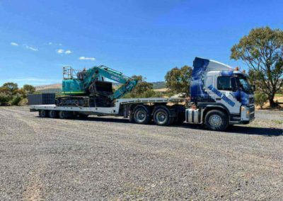 Mega tilt tow truck loaded with a 14 tonne excavator - heavy towing from Sellicks to Seaford
