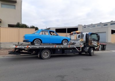 Towing a restored Datson 1600 in Adelaide, in the Adelaide eastern suburbs